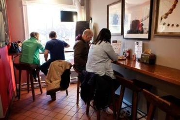 Customers fill the small dining area at Chilacates.